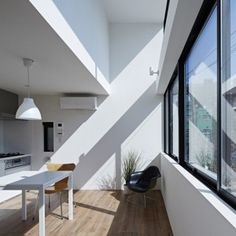 """PANDA's Asakusa Apartments feature  rows of """"picture frame"""" windows"""