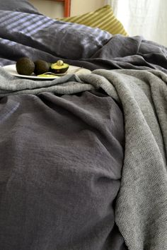 Charcoal stonewashed linen duvet cover/ quilt cover/ doona cover. Queen and King sizes. Medium weight linen. All-year-round bedding.  True, deep charcoal colour linen duvet /quilt cover is made of luxurious, extra wide, stonewashed genuine European linen. Duvet cover is closing at the bottom edge with mother shell buttons. Beautiful softly wrinkled linen texture. Perfect bedding for any season, be it hot summer or chilly winter nights. Regardless of the temperature outside will...