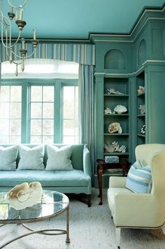 Save it for later. Turquoise room ideas - turquoise bedroom ideas for girls, boys, and adult. There's also another turquoise room ideas like living room and family room. Check 'em out! House Of Turquoise, Living Room Turquoise, Turquoise Walls, Aqua Walls, Turquoise Hotel, Turquoise Office, Coral Rug, Turquoise Furniture, Turquoise Pillows