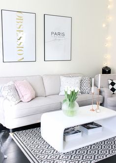 Rug, simple coffee table and simple prints