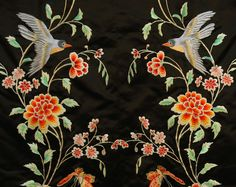 Chinese export coat. Black satin decorated with colorful silk and silver metallic embroidery of flowering stems with blue birds and butterflies trimmed with couched metallic cloud border and silver frogs, pink silk damask lining, 1960's