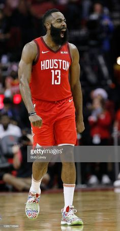 3b91e1e0dfc5 James Harden of the Houston Rockets reacts after making a three point.