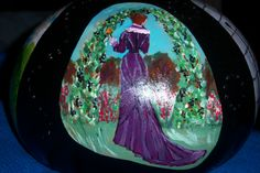 "side two of Sharon's ""Women throughout history"" painted gourd hanging lamp."