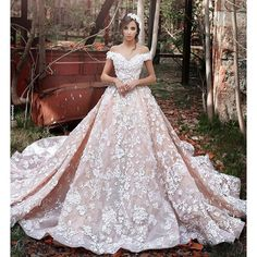 Off-the-shoulder gowns are one of the biggest #bridal trends of the moment! This princess-inspired dress by #sadekmajedcouture is a heart-stoppingly beautiful take on the style.