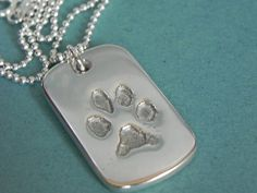 Paw Print Jewelry - Your dog's actual paw print stamped into a shiny thick dog tag style solid silver keychain. Your pups real pawprint is scaled to fit in this keepsake gift for dog lovers. Back personalized with dog's name or short phrase.  Honor your new puppy, rescue dog, shelter dog. Makes perfect pet memorial gift or present from the dog :)