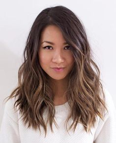 layered wavy brunette hairstyle