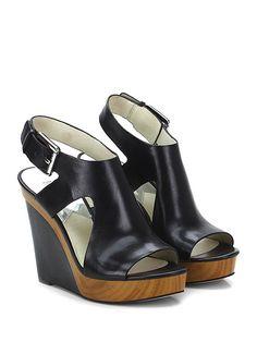 Michael Kors - Zeppe - Donna - Zeppa in pelle con cinturino e suola in gomma. Tacco 120, platform 35 con battuta 85. - BLACK - € 175.00
