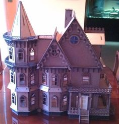 Leon Gothic Victorian Mansion Half INCH SCALE KIT it measures 24Wx10Dx26H It has detailed porch framing, Victorian Gingerbread - Corbels, Victorian Gingerbread Gable Ornaments, railings, Window frames, Plexiglas window inserts, detailed sub frame