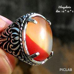 Cincin Permata Tiga Warna ( el Three Colour ) 1. Batuan natural asli indonesia 2. Dimensi 18 * 12 * 5 3. Ring Germanium ukuran 7 - 8 ( 17 - 18 ) 4. Size Kantoran 5. Perpaduan warna serasi yang jarang ( Mirip Bendera Spanyol ).