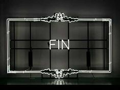 Ornate 'Fin' (End in French) neon sign
