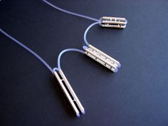 necklace. water drops between tubes. sterling silver and pvc. Jinmi Lin