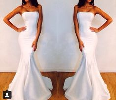 Simple fitted white satin wedding dress...I think it's simplicity makes it so sexy