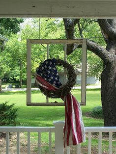 Love this wreath inside an empty frame with a flag draped. Nice. Americana and the 4th!