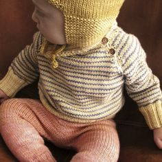 beautiful knitted baby sweater. Merino wool blue grey and warm yellow. So cute