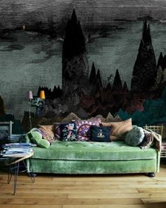 Great wall decor in this boho living room..  But I like the sofa very much.