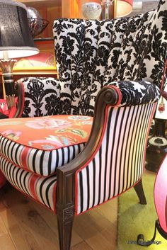 I love the idea of a new spin on something old...especially the awesome lines of an old chair--with something new--my fave chevron, lattice or trellis prints. (I love this funky mix and match though)