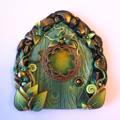 The Green Fairy, Fairy Door,Pixie Portal by Claybykim on Etsy Polymer Clay Projects, Polymer Clay Creations, Indoor Mini Garden, Fairy Village, Green Fairy, Feb 2017, Garden Angels, Fairy Homes, Gnome House