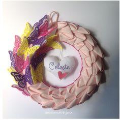 http://www.misshobby.com/it/oggetti/ghirlanda-rosa-con-farfalle-e-cuore-ricamato-nome-bimba