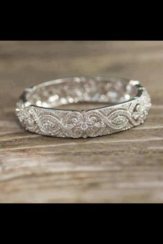 Would absolutely love this but doesn't have to be as many diamonds, could be more metal with etching type stuff and some diamonds