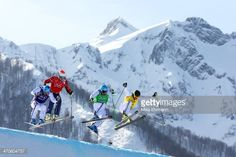 Gold medallist Jean Frederic Chapuis (green top) of France leads from silver medallist Arnaud Bovolenta of France (blue top), Brady Leman (red top) of Canada and bronze medallist Jonathan Midol (R) of France during the Freestyle Skiing Men's Ski Cross Big Final on day 13 of the 2014 Sochi Winter Olympic at Rosa Khutor Extreme Park on February 20, 2014 in Sochi, Russia.
