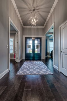 I like the clean straight lines of the molding around the front doors. Not too embellished.