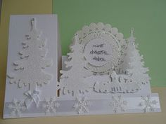 sparkly all white snow scene on a side-step card...