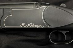 MY MOSSBERG MAVERICK 12 GAUGE OVER/UNDER SHOTGUN