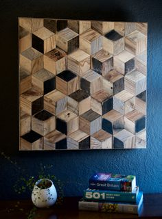 Reclaimed Wood Hexagon Pattern Wall Art The item is made from reclaimed timber with its original patina. The original wood grains, scratches, odd nail holes and patina makes this item unique. Different types of wood has been used in this project(Oak, Pine, Some Exotic Woods). It has got a tiny frame made of scaffolding board edge. All is sanded smoothly and left with no finish (to preserve its original look). Ideal item to be hung in hallway, living room etc as a nice touch to your wall. ...