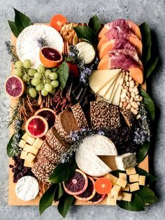 Feast your eyes on a spread that is sure to fill you up. Our signature charcuterie boards and grazing tables a la carte for small groups to large gatherings of up to 300 guests. #cheeseboard #cheeseplate #grazingtable #cheeseplatter #cheese #freshfruit