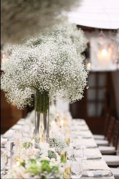 Baby's breath flowers with lil candles inexpensive way to decorate table settings with flowers
