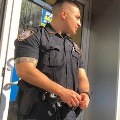 "ruddycherry: "" matthewrettenmund: ""Blue steel. #cops #police #arms #biceps #muscles #muscular #tattoos #guy #guys #men #menofnyc #menofnewyork #nyc #nycmen #newyork #newyorkmen #newyorkcity #hot #handsomeman #handsome #boyculture "" Them RuddyCherry ..."