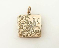 """Antique Victorian Gold Filled locket with etched lighthouse and """"FAB"""" monogram."""