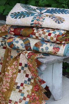 Laundry Basket Quilts Blog | Today's Quilts, Tomorrows Memories.  Love the colors in these quilts.