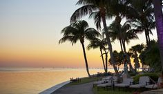 Grove Isle Hotel & Spa: Relax by the pool or along the resort's bayfront areas.  #Jetsetter  #JSSunrise