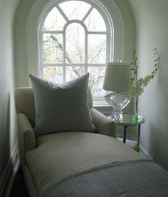 I desire a reading nook like this with a window in our room :) doesn't that look cozy?