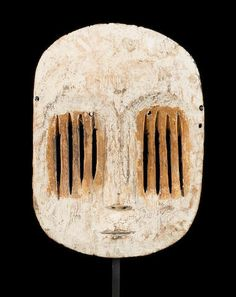 A rare Mbole-Yela mask, Democratic Republic of Congo height 11 1/2in   Provenance: Ernest Godefroid, a Belgian engineer working in the Congo, collected in situ ca. 1940-50 Pierre Dartevelle, Brussels