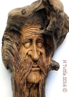 """""""A Philosopher's Pompadour"""" 8½ inches tall and just under 4 inches across his puffy hair. This wood spirit hangs showing off his ¾ profile. Signed and dated: N. Tuttle 3/9/16"""