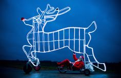 """German bicycle designer Didi Senft, known during the Tour de France as """"El Diabolo"""", presents his latest Christmas-themed construction in Storkow, Germany on November 29, 2012. (Patrick Pleul/AFP/Getty Images)"""