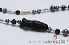 Design, Monique Swinkels. #female #figure #flameworking #necklace