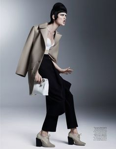 Steven Meisel's Starchitecture : Stella Tennant wearing Balenciaga silk and wool trench coat silk crepe skirt and wool trousers.