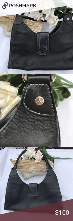 """Mercedes - Benz Black Purse Ladies here is your chance to own a Mercedes -Benz purse with the logo on the drop handle See all pictures Very good preowned condition. May of been a gift from the dealer for a Mercedes purchase. Neat bag The inside metal Tag reads The Collection By Mercedes Benz Has about a 11"""" drop and 12"""" across All measurements are approximate Please ask any questions you may have before your purchase. Mercedes Benz Collection Bags Satchels"""