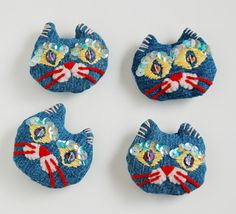 Cat brooches recycled from jeans