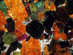 Martian meteorite thin section viewed in cross-polarized light. Genuine rocks from space for collectors and science available at Galactic Stone & Ironworks.