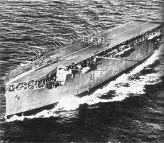 HMS Argus, the first Aircraft carrier to have a full flight deck and a lift. The aircraft is a Blackburn biplane. The Argus was built in 1918, by converting an incomplete Italian liner. Survived scrapping post WWI & briefly escort carrier & transport in early WWII.