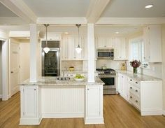 Image result for wrapped kitchen counter top island around brick pillar