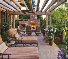 Wood Pergola With Lounge Chairs and Fireplace