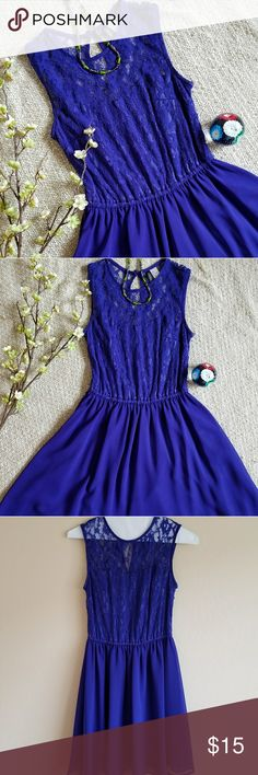 Beautiful cobalt blue dress Beautiful color depending on the light either purple or a cobalt color  Used in excellent condition, only worn once  Beautiful lace top  Lined Back closure, no zipper, some stretch in waist and top Divided Dresses