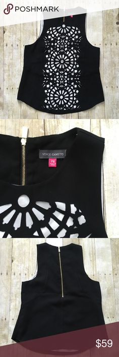 """Beautiful laser cut out sleeveless top. Nwot New without tags. Black with laser cut outs- white under layer. Gold exposed zipper on back. Measurements lying flat: across chest 18.5 inches and length 25 inches.  ❌ No trades or off Poshmark transactions.   👌🏻Quick shipping.   💁🏻Offers welcome through """"Make an Offer"""" feature.   👗👠 Bundle discount.   ❔ Feel free to ask any questions. Vince Camuto Tops Blouses"""