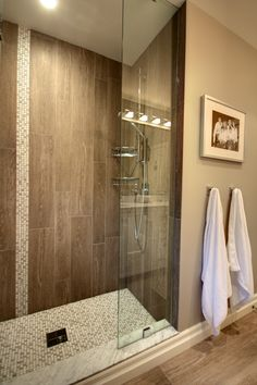 The shower tile layout with vertical large tiles and contrast accent tiles are g. The shower tile Large Tile Bathroom, Wood Tile Shower, Bathroom Renos, Bathroom Ideas, Wood Bathroom, Bathrooms With Wood Tile, Vertical Shower Tile, Shower Walls, Basement Bathroom