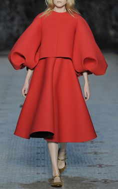 This **Dice Kayek** dress features an oversized puff sleeve, layered bodice, and flared midlength skirt.